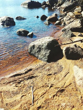 Beach Sand Shore Nature Outdoors No People Sea Sunlight Water Beauty In Nature Finland Sand & Sea Springtime Seashore Sunny Morning Bright Light Spring Has Arrived Stones & Water Warmth Of The Sun Finland