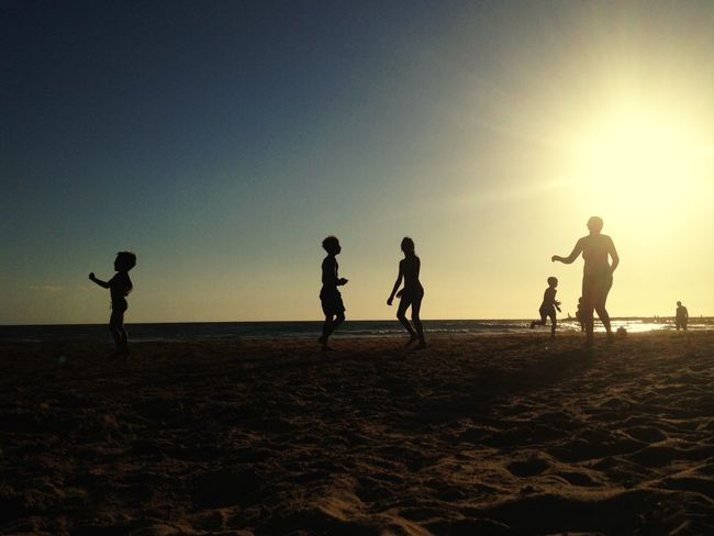 Dancing with the sun... Summer Views Landscape summer sports Group Of People Sky Silhouette Beach Land Sunset Real People Sport Lifestyles People Nature Water Sea Togetherness Beauty In Nature Playing Ball Love The Game