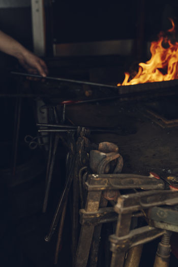 A Blacksmith is working in the blacksmith shop Burning Fire Fire - Natural Phenomenon Heat - Temperature Flame Indoors  Workshop Metal Fireplace Metal Industry Forge  Blacksmith  Blacksmithing Blacksmith Shop Blacksmith Tools Iron Arm Plant Working Hard Tradition Traditional Hot Expierence Skills