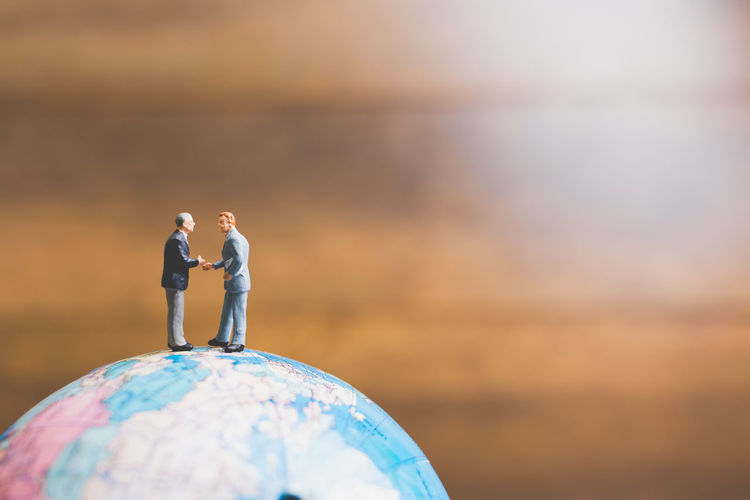 Background Business Businessman Closeup Communication Concept Figure Figurine  Global Handshake Human Investment Journey Little Macro Male Man Mini Miniature People person Professional Sign Small Success Suit Tourist Toy Travel Trip Vacation World