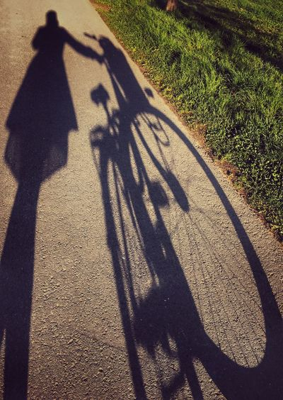 Cut And Paste Shadow Focus On Shadow Sunlight Long Shadow - Shadow High Angle View Bicycle Transportation Day Real People Men Road Outdoors Grass Lifestyles Nature People Woman's Shadow Woman Girl Female Silhouette Silhouette_collection Creative Silhouettes
