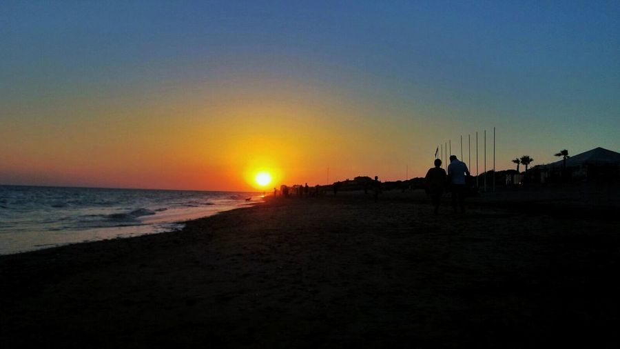 Sunset Beach Silhouette Sea Sky Nature Sand Outdoors Tranquility People Adult Adults Only Beauty In Nature Scenics Men Only Men Night Horizon Over Water Water