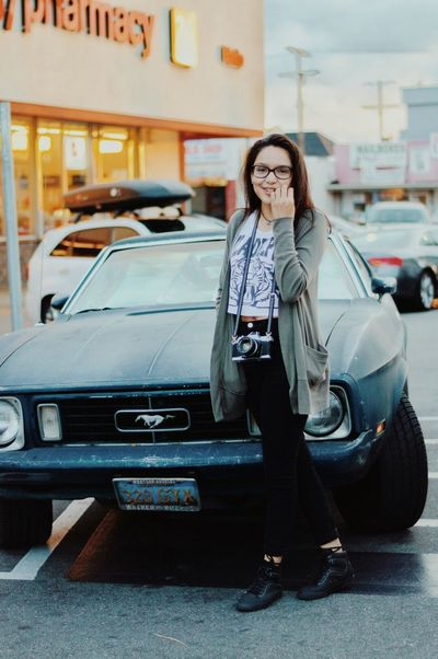 The Portraitist - 2016 EyeEm Awards Street Street Photography Portraitist - 2016 Eyeem Awards Urban Vintage Retro Styled Portraiture Portrait Of A Woman Portraits Vibrant Colors Portrait Of A Girl Modeling Spring 2016 Model Portrait Photography Vintage Style Mustang Mustang Car Ford Mustang Classic Car
