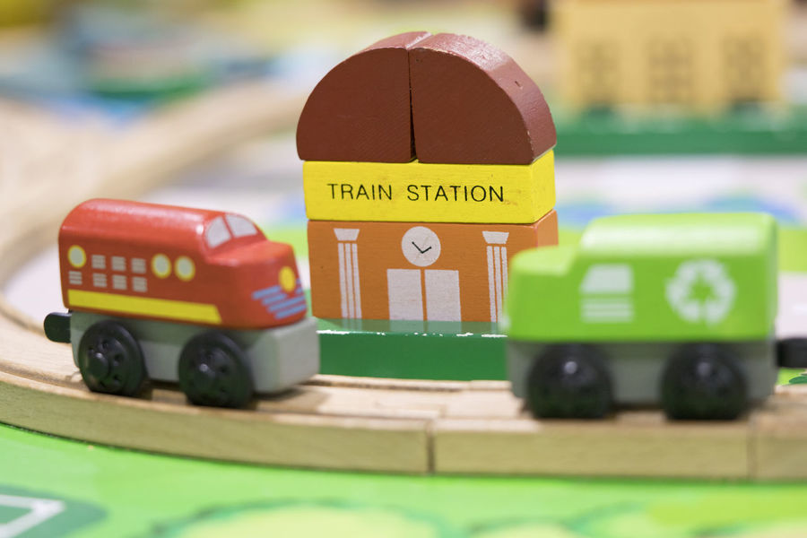 Wooden toy two trains on road with hospital in backdrop (selective focused),Toys for kids indoor playground Wooden Toys Wooden Toy Block Toy Selective Focus Text Western Script Close-up Car Transportation No People Indoors  Still Life Toy Car Mode Of Transportation Motor Vehicle Green Color Number Toy Block Communication Wheel