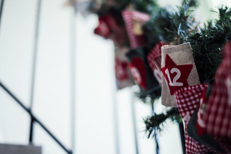 Close-up of christmas decorations hanging on railing