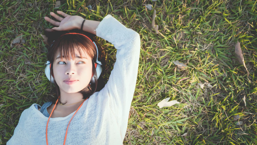 Directly above shot of woman listening music