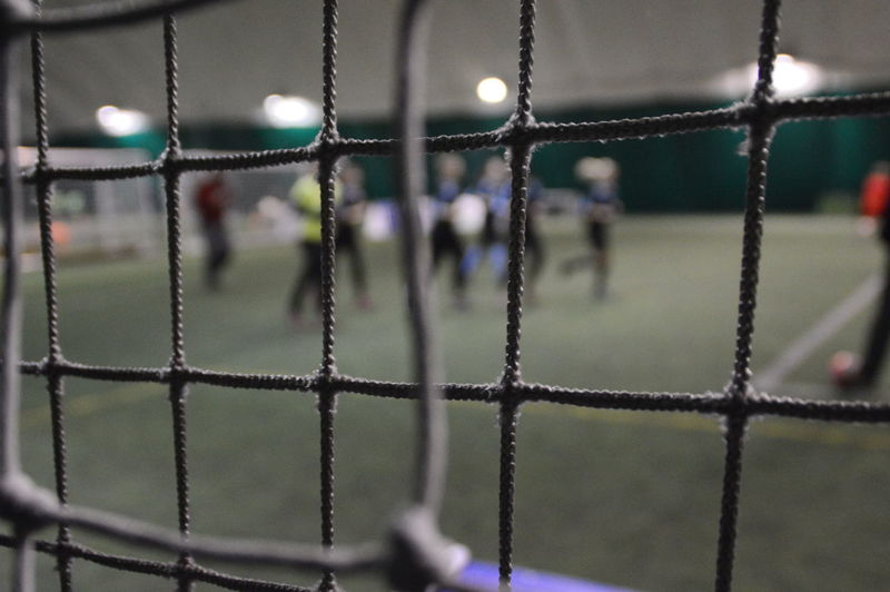 Focus On Foreground Green Indoors  Lights People Players Protection Soccer Soccer Field Soccer Goal