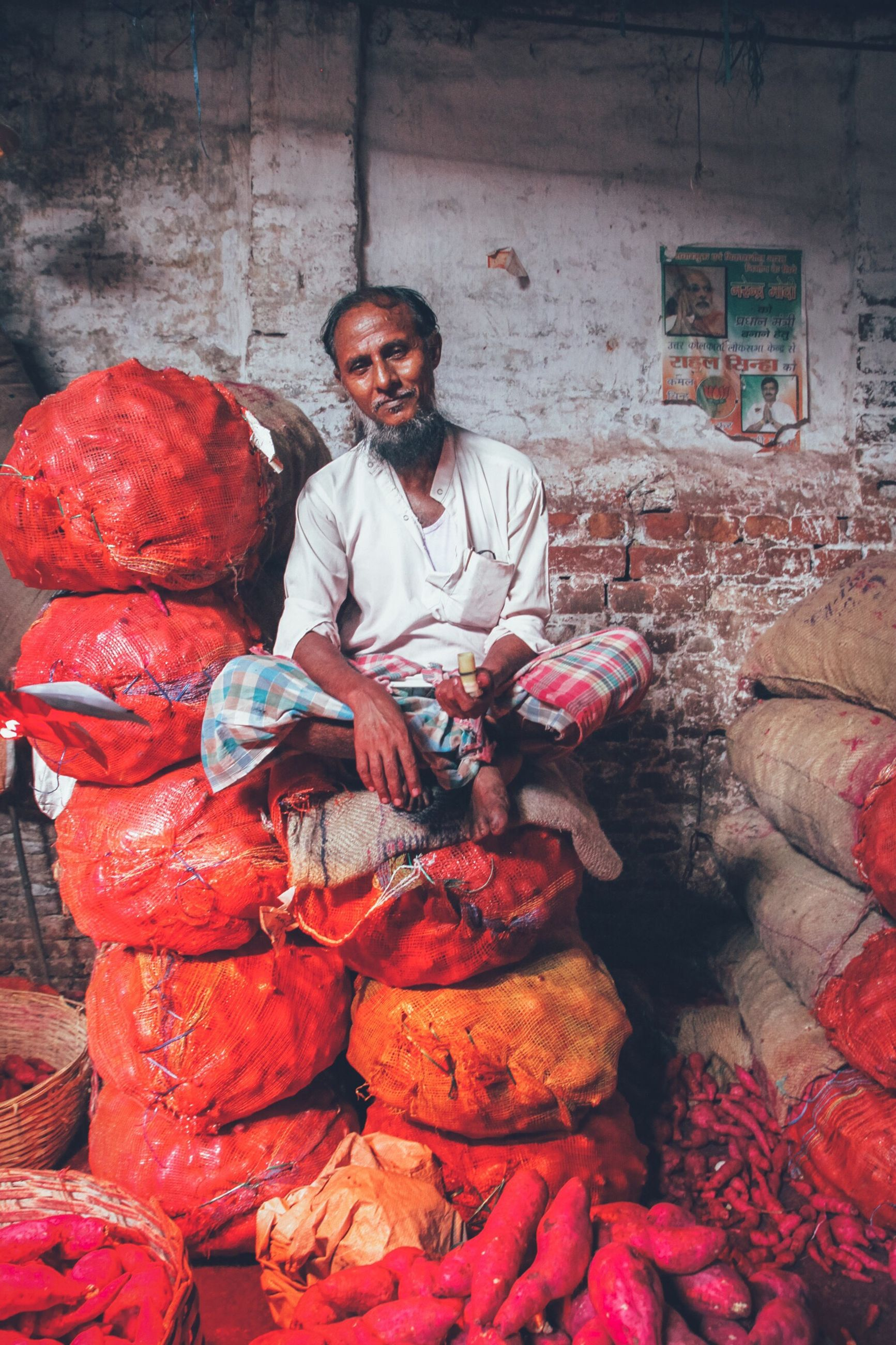 real people, small business, market vendor, portrait, adults only, one person, looking at camera, cultures, front view, market stall, selling, only men, men, one man only, business finance and industry, mature adult, occupation, market, working, people, adult, indoors, freshness, butcher, day