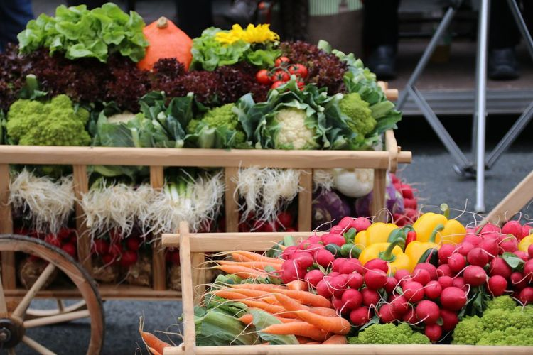 High Angle View Of Various Vegetables On Cart At Market