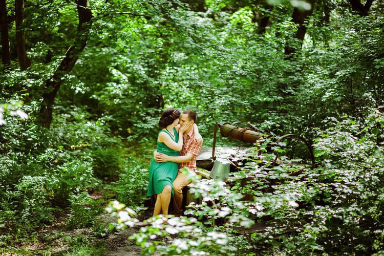 couple relax together in summer forest with swing background. Summer time in green meadow. Outdoors Together Love Dating Couple Relationship Relaxing Leisure Activity Lifestyles Lifestyle Two People Field Green Grass colour of life Picnic Forest Wildflower Summer Spring Happiness Plant Tree Young Adult Nature Green Color Casual Clothing People Couple - Relationship Romantic