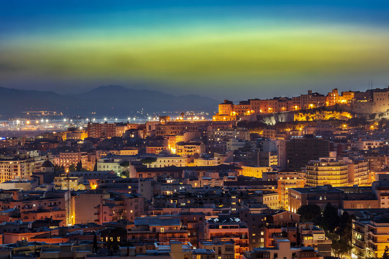 Cagliari Night View Cagliari Sardinia Italy Panorama Night Dusk Blue Hour Architecture Cityscape City Illuminated Sky Building High Angle View Outdoors Built Structure Building Exterior View Sunset Bay Harbor Old Town Vacations Horizon Over Water Urban Skyline
