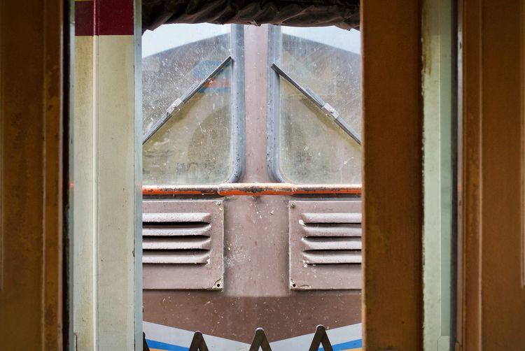 Wiper on windshield seen through train