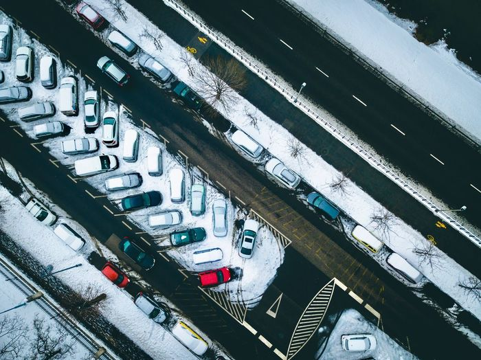 High angle view of cars parked on snow covered parking lot