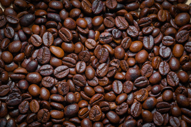 Coffee - Drink Coffee Roasted Coffee Bean Backgrounds Full Frame Brown Food And Drink Close-up Freshness No People Food Large Group Of Objects Indoors  Caffeine Abundance Pattern Still Life Dark Textured  Drink Textured Effect