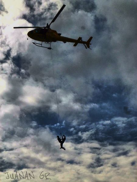 Myjob Mylife Castillayleon EurocopterAS350 Eurocopter Rescue Helicopter Flying Sky Cloud - Sky Low Angle View Mid-air Silhouette Day Adventure Outdoors Nature