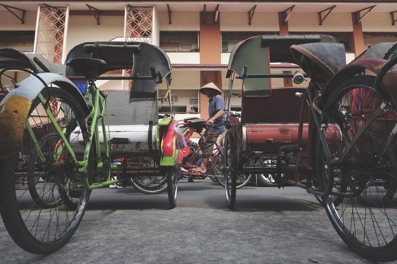 Transportation Mode Of Transportation Land Vehicle Bicycle Stationary No People Outdoors Wheel Parking Lot Built Structure Seat Architecture Street In A Row Parking City Day Absence The Traveler - 2018 EyeEm Awards Capture Tomorrow