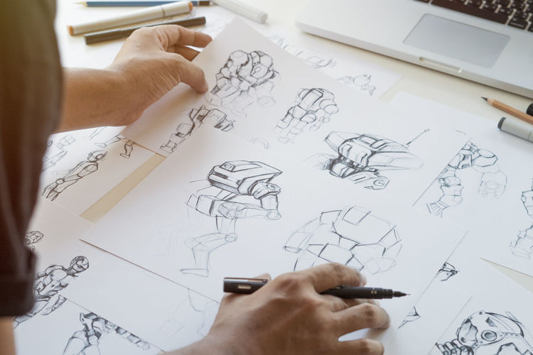 High angle view of man working on paper