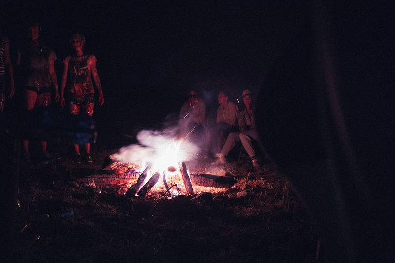 Campfire Campfire Night Nightphotography Bonfire Burning Campfire Campfire Flames Dark Event Fire Fire - Natural Phenomenon Firewood Flame Glowing Group Of People Heat - Temperature Illuminated Log Men Nature Night People Real People Wood Wood - Material