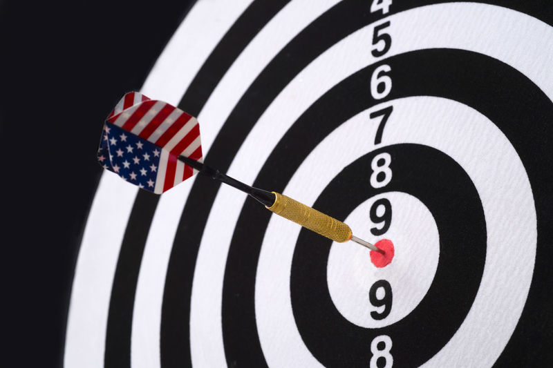 Center target of darts isolated on a black background Object Game Concept Circle Success Closeup Background Dart Dartboard Strategy Sport Board Marketing Target Business Center Winner Point Objective Arrow Bullseye Financial Targeting Symbol Perfect Mark Perfection Metaphor Targeted Planning Light Challenge Market Win Goals Achievement Aim Idea Score Hit Spot Audience Archery Number Play Accuracy Recreation  Leisure Competition Sports Target Striped Studio Shot Skill  Indoors  No People Relaxation Winning Close-up White Color Flag Aiming Red Leisure Activity Cut Out Black Background Hitting