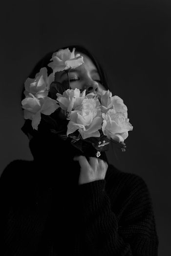 The Portraitist - 2019 EyeEm Awards Flower Flowering Plant Plant Headshot One Person Freshness Portrait Indoors  Inflorescence Close-up Flower Head Studio Shot Beauty In Nature Nature Fragility Petal Vulnerability  Real People Lifestyles Black Background Human Face Obscured Face Flower Arrangement Bouquet