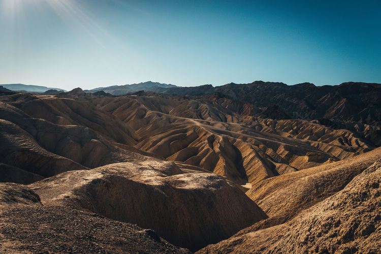 near furnace creek [Death Valley] Arid Climate Beauty In Nature Clear Sky Day Desert Geology Landscape Mountain Mountain Range Nature No People Outdoors Physical Geography Rock - Object Scenics Sky Sunlight Tranquil Scene Tranquility Travel Destinations