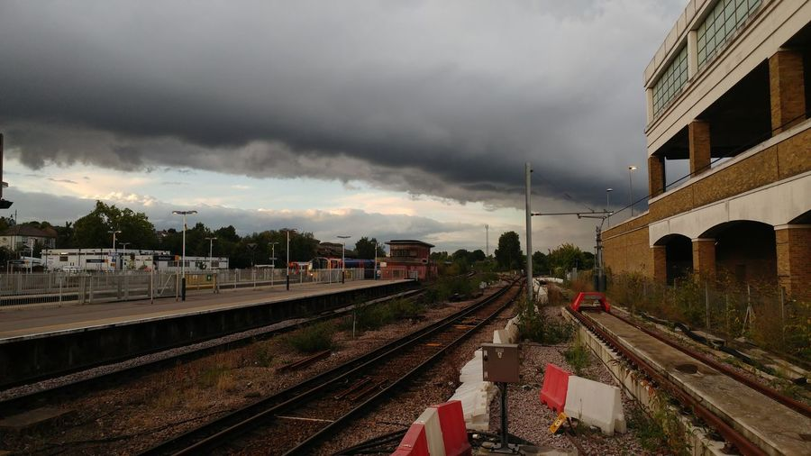 Cloudy Railroad Track Rail Transportation Storm Cloud City Outdoors No People Sky Day Train - Vehicle Cloud - Sky Colide Coliding Lines Built Structure Architecture