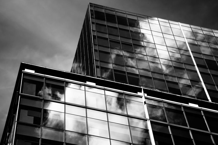 Reflections Be. Ready. EyeEmNewHere Black And White Friday Window Sky Outdoors Modern Low Angle View Glass Cloud - Sky Built Structure Building Exterior Blackandwhite Architecture Reflection Cloud Black & White