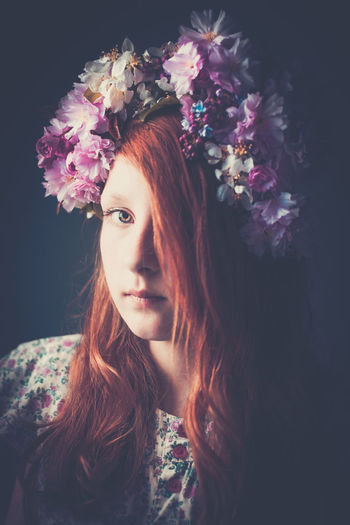 Portrait of girl wearing floral garland