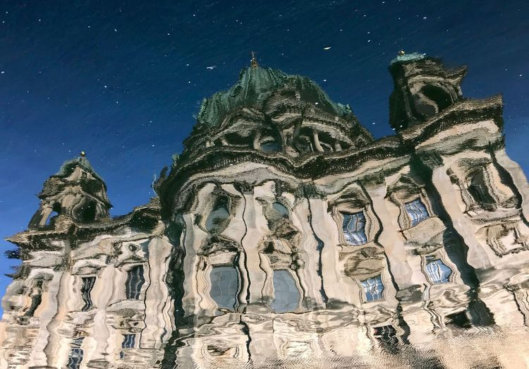 Reflection of the Berlin Cathedral Distortion Gaudi Style Cathedral Berlin Berliner Dom Built Structure Sky Architecture Religion Building Exterior Spirituality Place Of Worship Building Low Angle View No People Travel Destinations Tourism Art And Craft History The Past Star - Space Creativity