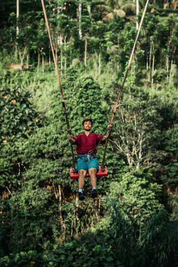 Man with rope in forest