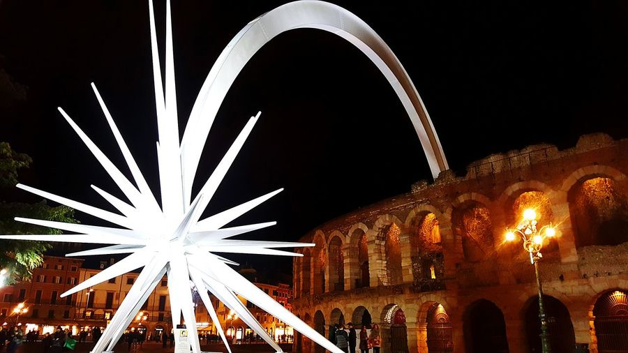 Miles Away Night Arts Culture And Entertainment Illuminated Celebration Ferris Wheel Christmas Holiday - Event Exploding Firework - Man Made Object Sky Star Verona Arena Light And Shadow Lights