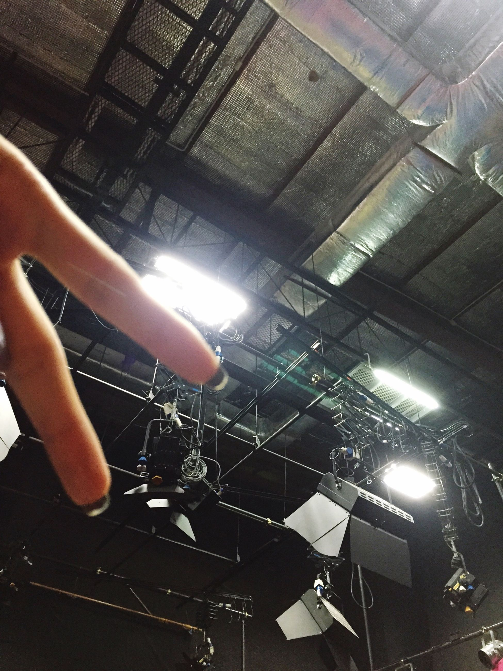 indoors, lifestyles, person, leisure activity, part of, technology, men, high angle view, unrecognizable person, personal perspective, holding, cropped, wireless technology, low section, human finger, standing