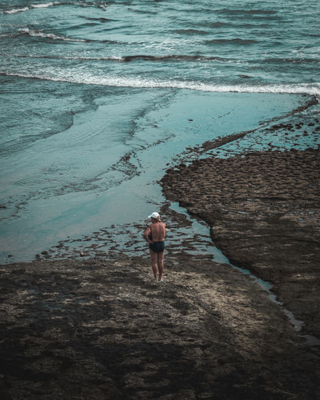 High angle view of man walking on beach