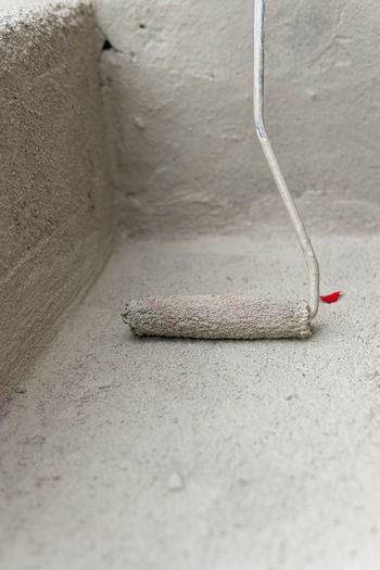 High angle view of pencil on floor against wall
