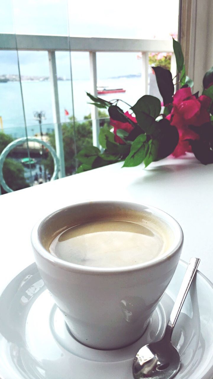 table, coffee cup, drink, indoors, refreshment, food and drink, freshness, coffee - drink, saucer, flower, no people, day, close-up, healthy eating, food, nature, ready-to-eat
