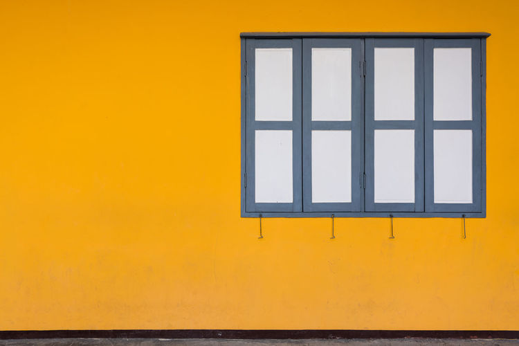 Old windows with orange wall Architecture Blank Building Building Exterior Built Structure Copy Space Design Geometric Shape House No People Orange Color Outdoors Shape Wall - Building Feature Window Window Frame Yellow