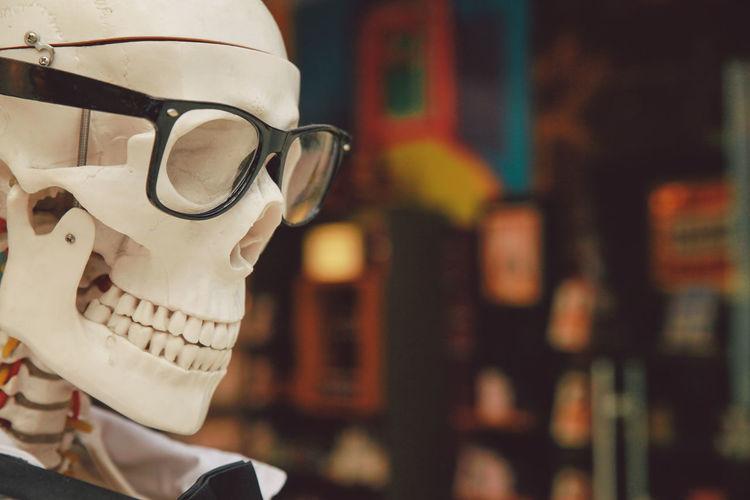 Close-up of eyeglasses on skeleton statue