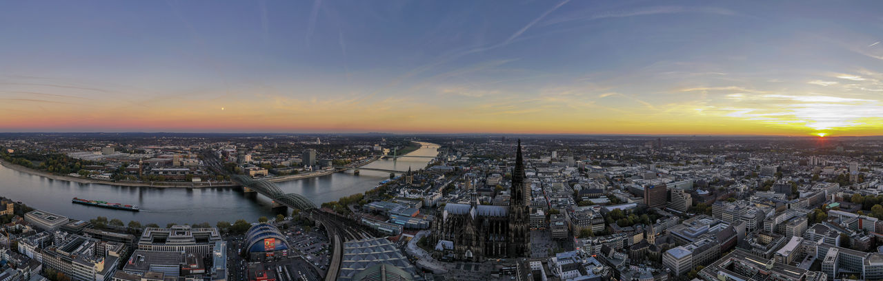 Cologne at sunset time Sky River Cityscape Architecture Aerial View Sunset Skyscraper Cathedral High Angle View Bridges Panoramic View