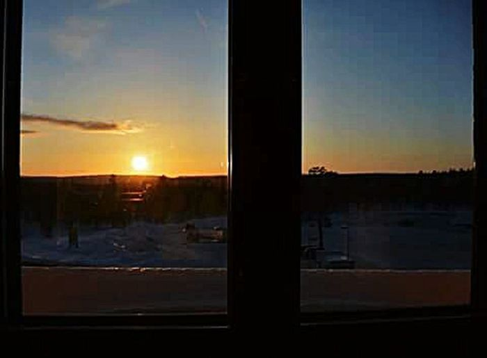 Throughout the window Sunset Saariselkå Lapland