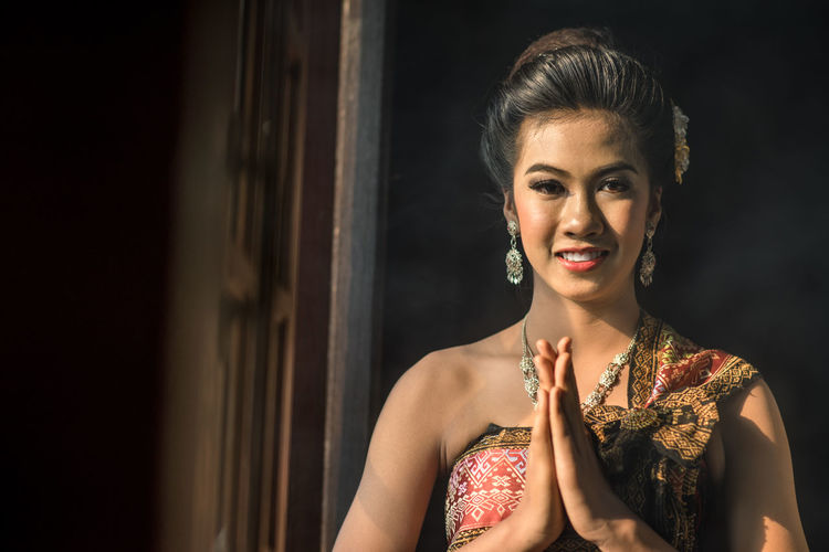 Portrait of beautiful thai girl in traditional thai costume Portrait Of A Woman Thai Thailand Waiting Gesture Thai Greetin Traditional Waist Up