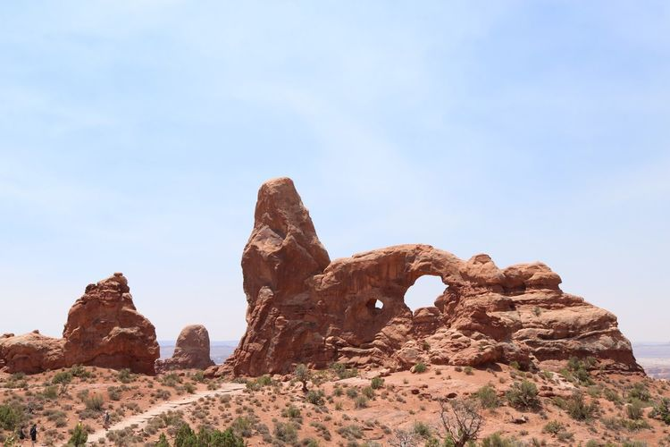 Low angle view of rock formations at arches national park against sky