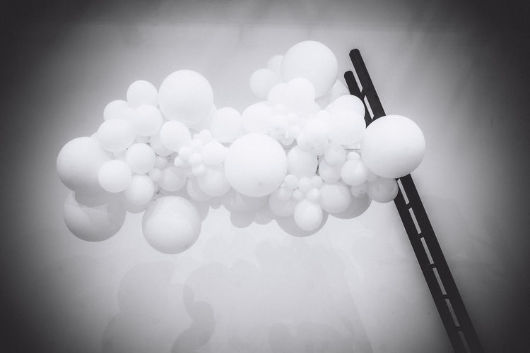 High angle view of balloons on table against wall