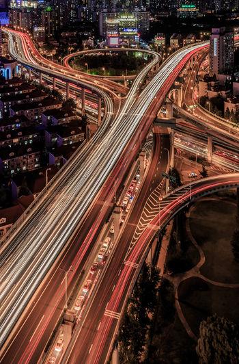 Light trails on bridges in city
