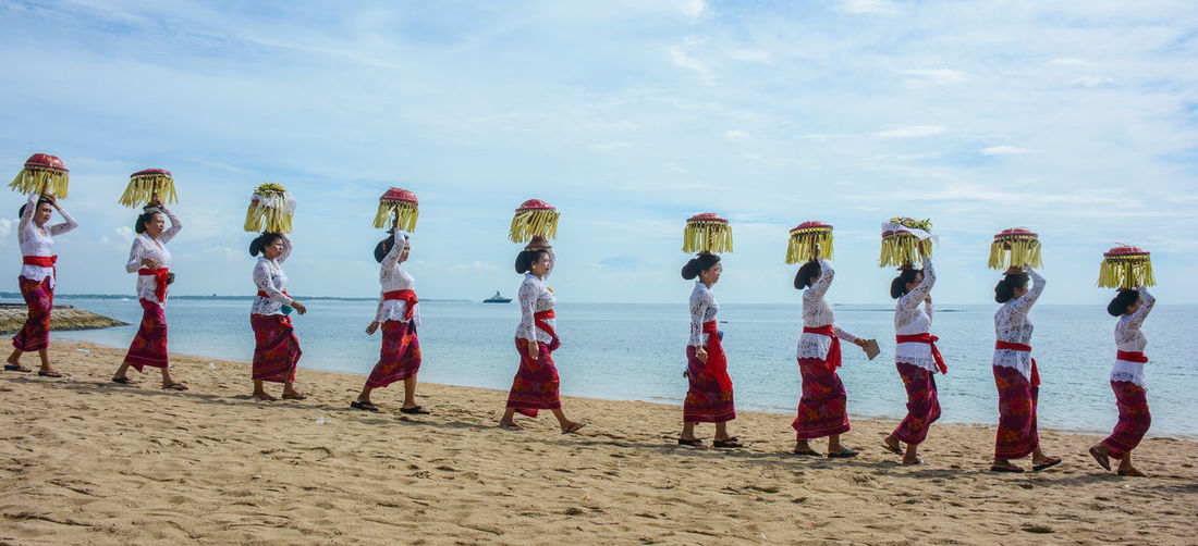 Melasti ceremony by Bualu villager in south kuta beach Balinesse Balinesse Women Balinesseculture Balinese Life Melasti Bali, Indonesia The Traveler - 2018 EyeEm Awards Water Army Soldier Sea Beach Sand Uniform In A Row Sky Cloud - Sky A New Beginning