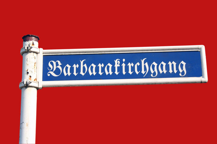 Old Road Sign - with an antique german scripture Ancient Ancient Civilization Barbará Close-up Communication German Germany Gothic Style Information Sign Kirchgang No People Old Red Background Religion Religion And Beliefs Road Road Sign Script Sign Signs Street Street Sign Text Vintage Western Script