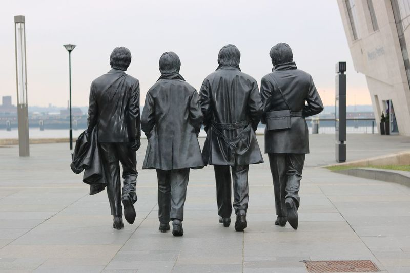 Beatles City Day Leaving Liverpool Liverpool, England Men Only Men Outdoors People Pier Head Liverpool Rear View Statue Walking Walking Away Weapon Young Adult Long Goodbye