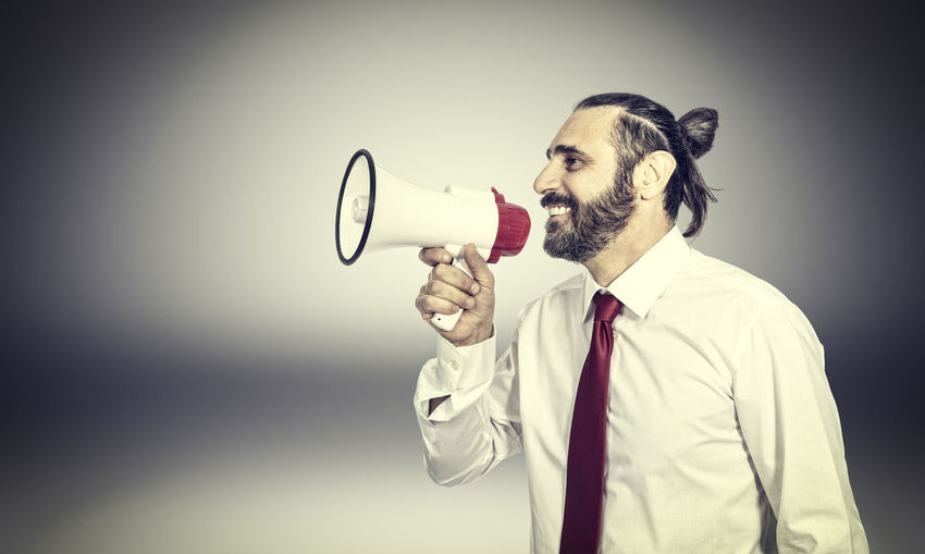 Male Adult Megaphone Business People Businessman Suit Executive  Background Man Success Young Speaker Shout Finance Announcement Communication Message Shouting Sound Isolated Noise Holding Loud Announce Enthusiasm Speaking Speech Voice