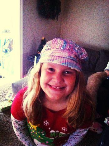 Rocking her sparkly hat!