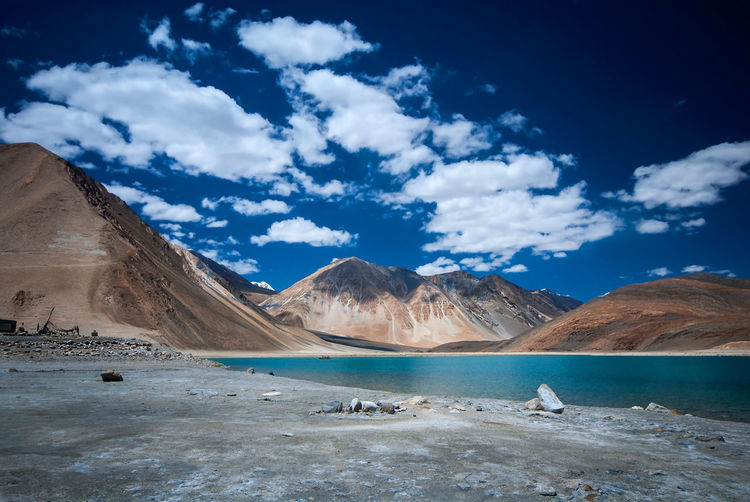 Pangong Tso the high grassland brackish lake, Sino-Indian border , Ladakh region, India. Arid Climate Beauty In Nature Blue Cloud - Sky Day Environment India, Ladakh, Lake, Land Landscape Mountain Mountain Range Nature No People Non-urban Scene Outdoors Pangong Tso, Scenics - Nature Sky Tibetan Plateau, Tranquil Scene Tranquility Water Wilderness,