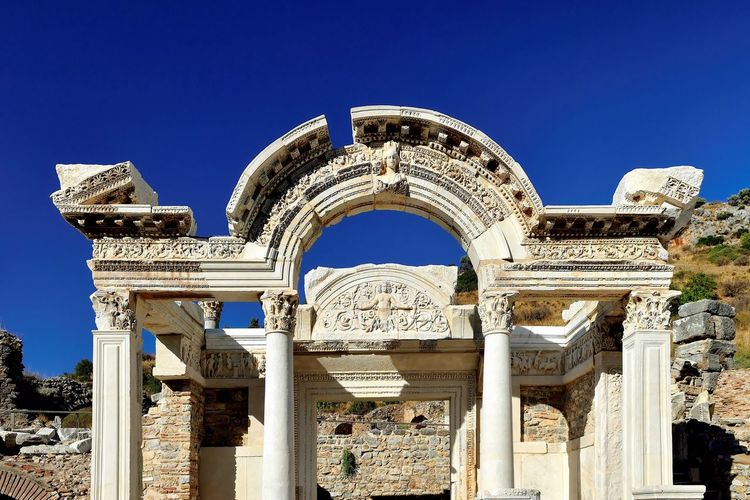 Low angle view of historical building against clear blue sky from ephesus